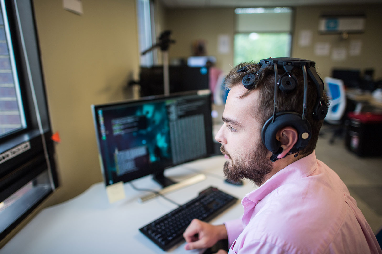Lead engineer James Hamet develops software for a dry version of the sensor cap that communicates brain activity. Photo by Austin Thomason, Michigan Photography.
